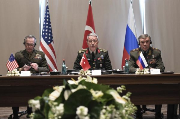 Turkey's Chief of Staff Gen. Hulusi Akar, center, U.S. Chairman of the Joint Chiefs of Staff Gen. Joseph Dunford, left, and Russia's Chief of Staff Gen. Valery Gerasimov attend a meeting in the Mediterranean coastal city of Antalya, Turkey, Tuesday, March 7, 2017. Turkey's military says the Turkish, U.S. and Russian chiefs of military staff are meeting in southern Turkey to discuss developments in Syria and Iraq. The meeting comes amid renewed Turkish threats to hit U.S.-backed Syrian Kurdish targets in the northern Syrian city of Manbij. (Turkish Military, Pool Photo via AP)