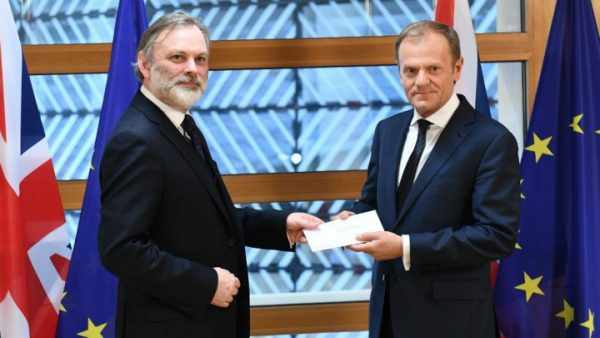 Britain's EU envoy Tim Barrow delivers Prime Minister Theresa May's formal notice of the UK's intention to leave the bloc to EC President Donald Tusk in Brussels on March 29, 2017.