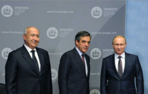Lebanese businessman Fouad Makhzoumi ( L) is shown with French presidential candidate François Fillon (C) and Russian president Vladimir Putin