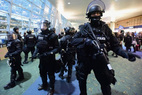 PORTLAND, UNITED STATES - JANUARY 29: Policemen stand guard during a demonstration against President Trump's immigration ban at Portland International Airport in Portland, United States on January 29, 2017. The President signed an executive order on Friday suspending all refugee admissions for 120 days as well as blocking entry for citizens from seven Muslim-majority countries for 90 days. (Photo by Alex Milan Tracy/Anadolu Agency/Getty Images)