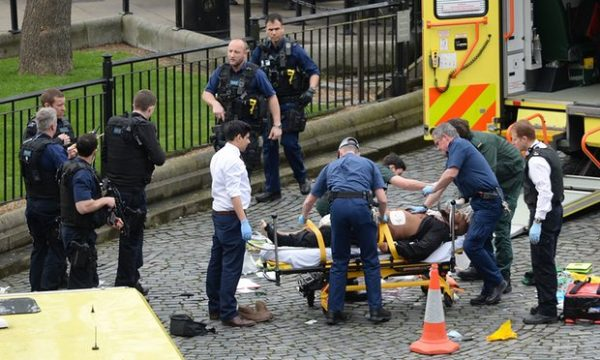 The suspected attacker Khalid Masood is treated by emergency services at the scene outside the Palace of Westminster. Photograph: Stefan Rousseau/PA