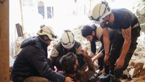 Members of the Syrian civil defence volunteers, also known as the White Helmets, remove a victim from the rubble of his house after an air strike by government forces early this month.(AFP File Photo)