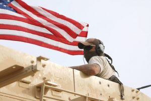 A member of U.S forces rides on a military vehicle in the town of Darbasiya next to the Turkish border, Syria April 28, 2017. REUTERS/Rodi Said REUTERS