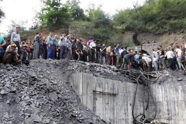 People gather at the site of an explosion in a coal mine in Golestan Province, in northern Iran. Tasnim News Agency/via REUTERS