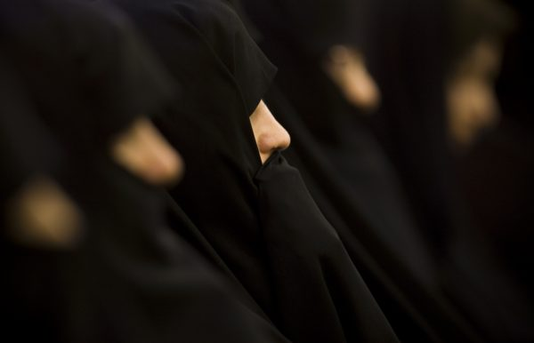 Iranian women dressed in  black chadors