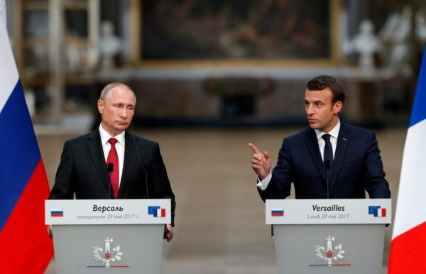 French President Emmanuel Macron (R) and Russian President Vladimir Putin (L) give a joint press conference at the Chateau de Versailles before the opening of an exhibition marking 300 years of diplomatic ties between the two countries in Versailles, France, May 29, 2017.   REUTERS/Philippe Wojazer