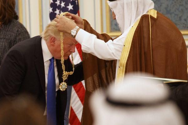 Saudi King Salman presents President Donald Trump with The Collar of Abdulaziz Al Saud Medal at the Royal Court Palace, Saturday, May 20, 2017, in Riyadh. (Evan Vucci/Associated Press)