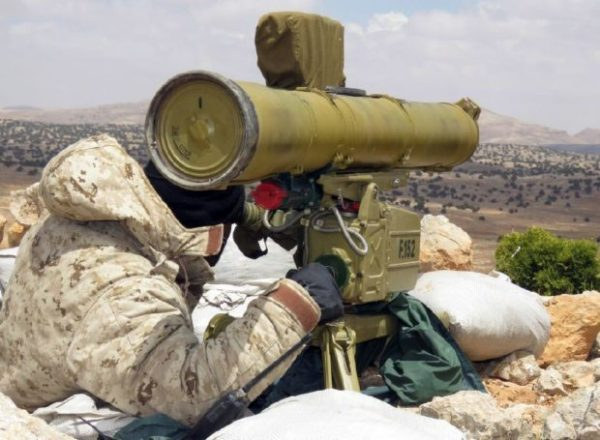 """A """"Hezbollah"""" member patrols the Qalamoun hills close to the Lebanese border with Syria. AFP file photo"""