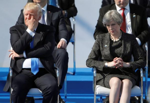 U.S. President Donald Trump (L) and Britain's Prime Minister Theresa May react during a ceremony at the new NATO headquarters before the start of a summit in Brussels, Belgium, May 25, 2017.    REUTERS/Christian Hartmann