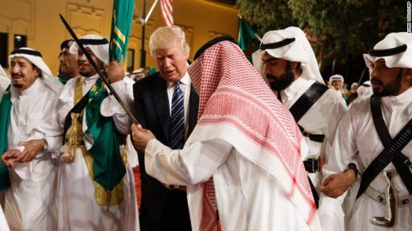 US President Donald Trump joins dancers with swords at a welcome ceremony ahead of a banquet