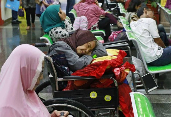 A patient takes a nap on her wheelchair as she waits with others at the registration desk at Dharmais Cancer Hospital in Jakarta, Indonesia, Monday, May 15, 2017. Global cyber chaos was spreading Monday as ... more