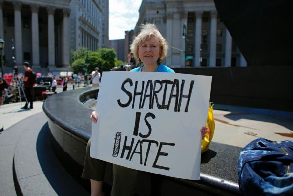 A Trump supporter holds up a sign during an anti-sharia law rally origanized by ACT for America on Saturday in New York. (Kena Betancur/AFP/Getty Images)