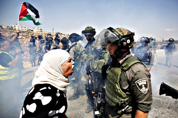 A Palestinian woman argues with an Israeli policeman during a protest against illegal Jewish settlements in the West Bank village of Nabi Saleh, near Ramallah...