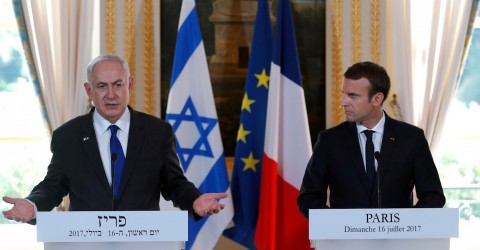 French President Emmanuel Macron is shown with Israeli Prime Minister Benjamin Netanyahu during a ceremony commemorating the 75th anniversary of the Vel d'Hiv roundup in Paris on July 16, 2017
