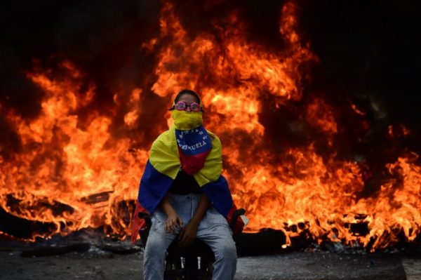 Dozens of people have died in Venezuela in more than two months of protests against President Nicolas Maduro (AFP Photo/Ronaldo SCHEMIDT)