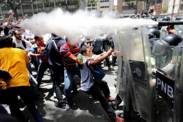Demonstrators clash with security forces during an opposition rally in Caracas, Venezuela. REUTERS/Carlos Garcia Rawlins