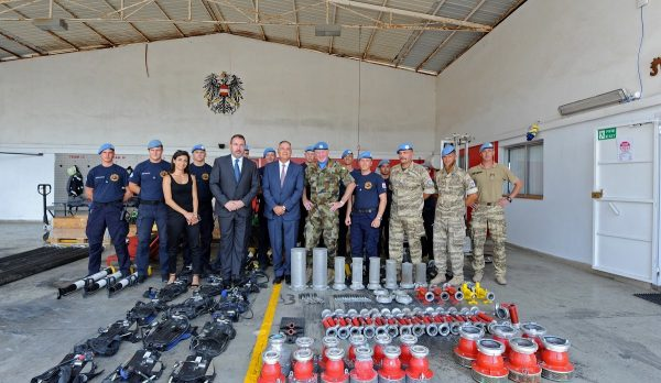Group photo of UNIFIL and Civil Defense officials with the donated UN assets.