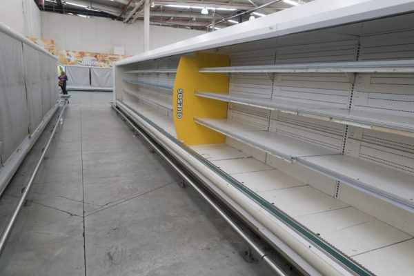 Empty refrigerator shelves are pictured at a Makro supermarket in Caracas, Venezuela, August 4, 2015. Venezuelan supermarkets are increasingly being targeted by looters, as swollen lines and prolonged food shortages spark frustration in the OPEC nation struggling with an economic crisis. Photo by Carlos Garcia Rawlins/Reuters