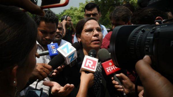 Indian Supreme Court advocate Farha Faiz (C) speaks to the media outside the Supreme Court in New Delhi on August 22, 2017