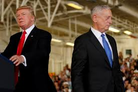 FILE PHOTO: U.S. President Donald Trump (L) is introduced by Defense Secretary James Mattis (R) during the commissioning ceremony of the aircraft carrier USS Gerald R. Ford at Naval Station Norfolk in Norfolk, Virginia, U.S. on July 22, 2017.
