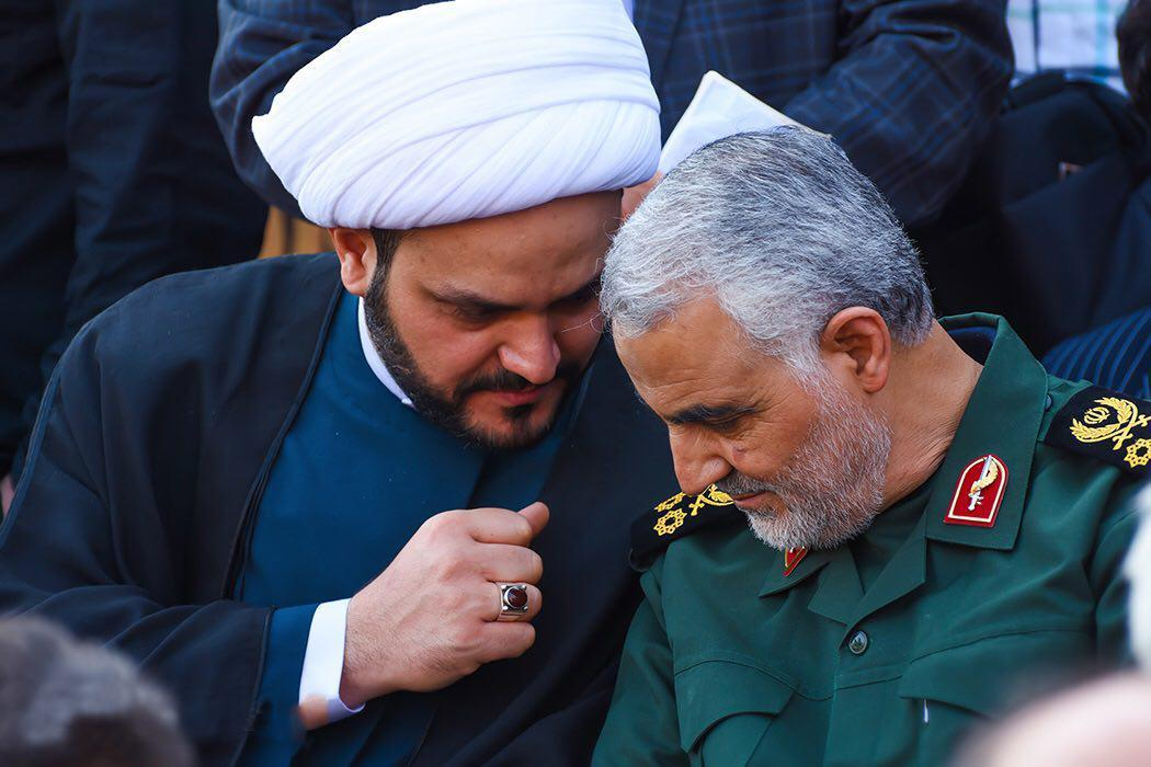 """Akram Kaabi Kaabi, who heads a Shi'ite Muslim militia named Harakat Hezbollah al Nujaba is shown with Iranian Revolutionary Guard Commander General Qassem Suleimani """"Suleimani , the head of the Qods Force, the foreign arm of Iran's Revolutionary Guards Corps has been described by the intelligence community as the """"most powerful operative in the Middle East today and the sole Iranian authority on Iraq."""" He has been organizing Iraqi forces and have become the de facto leader of Shiite militias throughout the Middle East."""