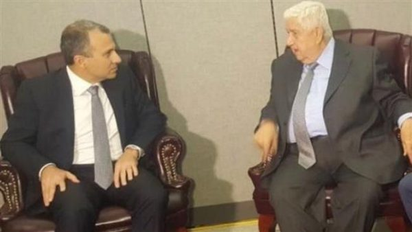 Lebanese Foreign Minister Jebran Bassil is shown with his Syrian counterpart Walid al-Muallem in New York. His meeting  has deepened divisions among Lebanon's politicians