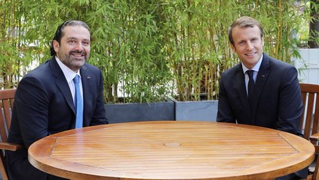 French President Emmanuel Macron (R) emphasized Friday that France will continue to stand by Lebanon following talks in Paris with Prime Minister Saad Hariri (L)