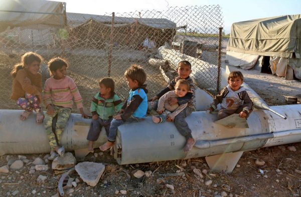 yrian children play as they sit on the tip of an abandoned missile at the Ash'ari camp for the displaced in the rebel-held Eastern Ghouta area outside the capital Damascus. AFP photo