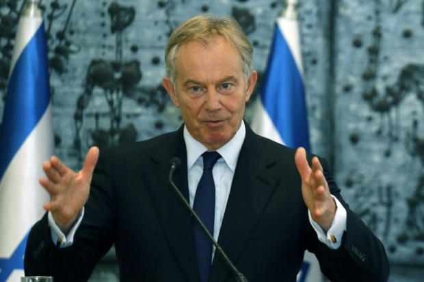 Former British PM Tony Blair has said for the first time that he and other world leaders were wrong to yield to Israeli pressure to impose an immediate boycott of Hamas after the Islamic faction won Palestinian elections in 2006.