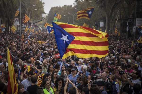 People celebrate the unilateral declaration of independence of Catalonia outside the Catalan Parliament, in Barcelona, Spain, Friday, Oct. 27, 2017. Catalonias' regional Parliament passed a motion Friday to establish an independent Catalan Republic. (AP Photo/ Emilio Morenatti)