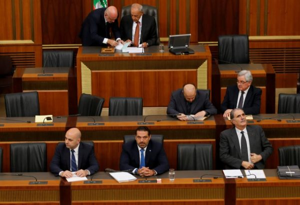 Lebanon's Prime Minister Saad al-Hariri (C) sits next to Minister of Public Health Ghassan Hasbani (L) during a parliament session in downtown Beirut, Lebanon October 9, 2017. REUTERS/Mohamed Azakir