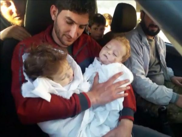 Abdel Hameed al-Youssef cradles the bodies of his nine month old twins after they were killed in a suspected chemical attack on Idlib in Syria on April 4, 2017.