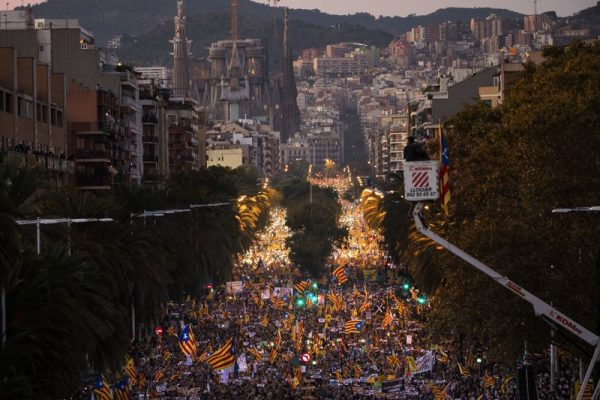 Hundreds of thousands of people backing Catalonia's bid to secede from Spain packed the streets in downtown Barcelona Saturday to demand the release of jailed separatist leaders.