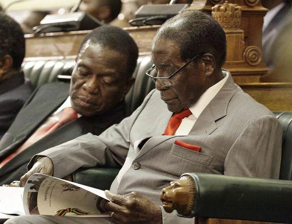 Emmerson Mnangagwa (L)  and Robert Mugabe in a file photo