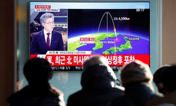 People watch a television broadcast of a news report on North Korea firing what appeared to be an intercontinental ballistic missile (ICBM) that landed close to Japan, in Seoul, South Korea. Photograph: Kim Hong-Ji/Reuters