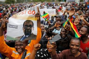 """Thousands of Zimbabweans took to the streets of the capital Harare   to demand the resignation of the country's long-ruling president.  Carrying signs reading """"Mugabe Must Go"""" and """"#Freshstart"""", jubilant Zimbabweans of all ages were out in force to show their opposition to the decades-old Mugabe regime and to celebrate the army's takeover"""