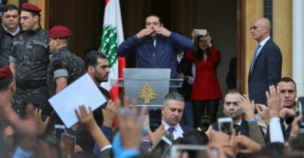 Lebanese Prime Minister Saad Hariri greets his supporters upon his arrival at his home in Beirut on November 22, 2017 after nearly three weeks of absence during which he announced his shock resignation from Saudi Arabia
