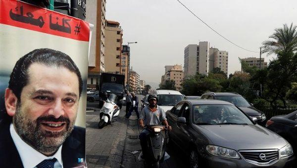 Cars pass next to a poster depicting Saad al-Hariri, who has resigned as Lebanon's prime minister, in Beirut, Lebanon,, Lebanon, November 13, 2017. REUTERS/Mohamed Azakir