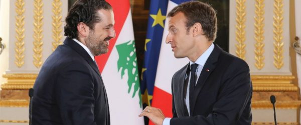 FILE - In this Sept. 1 2017 file photo, French President Emmanuel Macron, right, shakes hands with Lebanese Prime Minister Saad Hariri during a joint press conference at the Elysee Palace in Paris. Hariri has accepted an invitation to come to France after his surprise resignation from Saudi Arabia nearly two weeks ago that stunned Lebanon and rattled the region, the French president's office announced Thursday Nov. 16, 2017. (Ludovic Marin, Pool via AP, File)
