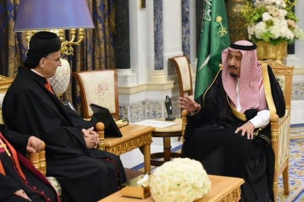 Lebanon's Christian Maronite Patriarch Bechara al-Rai in an historic visit to Saudi Arabia is shown with King Salman Bin Abdul Aziz Al Saud