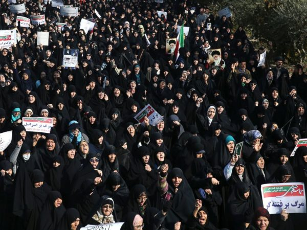Iranian protesters chant slogans at a rally in Tehran, Iran, Saturday, Dec. 30, 2017. Iranian hard-liners rallied Saturday to support the country's supreme leader and clerically overseen government as spontaneous protests sparked by anger over the co