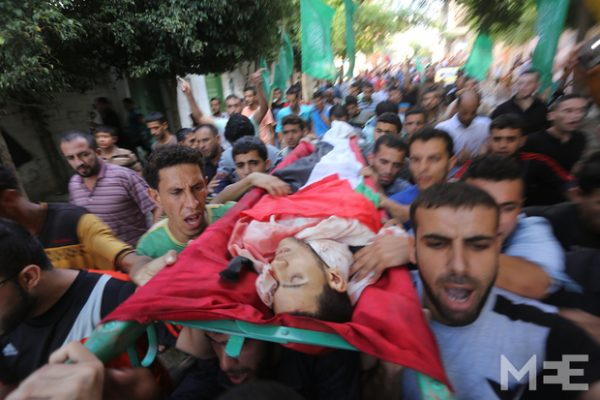 Families mourn activist killed by Israeli security services. At least six Palestinians were killed and over 137 injured when large-scale clashes broke out in the Gaza Strip, and two Palestinians were killed in the occupied West Bank, including one after an alleged stabbing attack, sources said on Friday. (Mohammed Asad/MEE)
