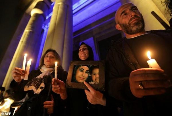Lebanese activists take part in a candle vigil to denounce violence against women outside Beirut's National Museum on December 23, 2017