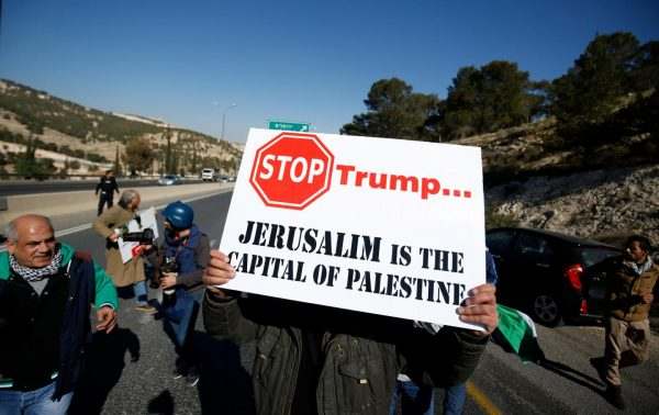 A Palestinian demonstrator in the West Bank protests against Donald Trump's call for the U.S. to relocate its Israeli embassy from Tel Aviv to Jerusalem, on January 20.