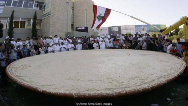 Lebanon holds the Guinness Book of World Records for largest plate of hummus, weighing 10,452kg (Credit: Anwar Amro/Getty Images)