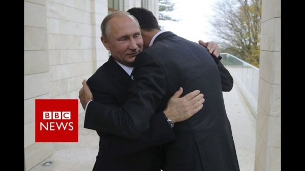 "Russian President Vladimir Putin is shown hugging Syrian President Bashar Assad. Syrian rebels and opposition groups rejected Russia's proposed peace talks in Sotchi. The called Russia an ""aggressor"" that has committed ""war crimes against Syrians"""