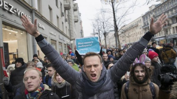 Russian opposition leader Alexei Navalny was wrestled to the ground by police and dragged feet first into a patrol wagon during an anti  government pProtest .  President Putin , a former KGB chief reportedly does not tolerate any opposition  Photo: AP
