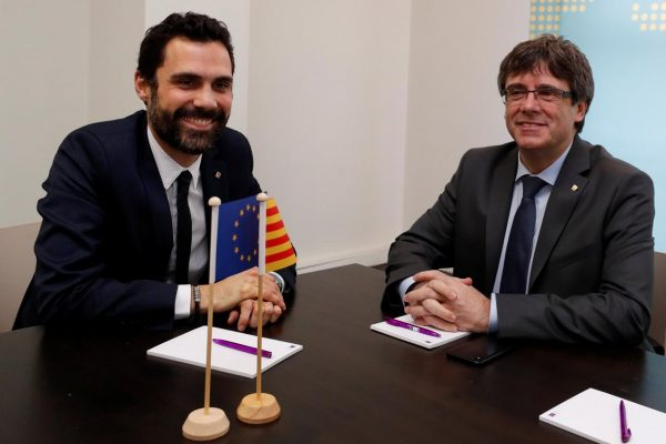 Dismissed Catalan president Carles Puigdemont (R) and Roger Torrent, Speaker of Catalan regional Parliament, sit at the start of their meeting in Brussels, Belgium, January 24, 2018. REUTERS/Yves Herman