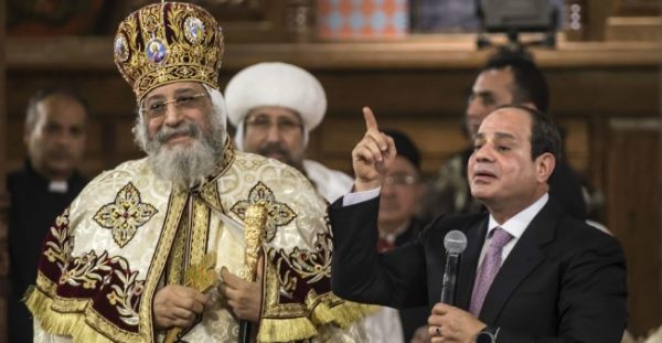 Egyptian President Abdel Fattah al-Sisi speaks near Coptic Pope Tawadros II (L) during a Christmas Eve mass at the Nativity of Christ Cathedral in Egypt's new administrative capital, 45 kms east of Cairo, on January 6, 2018.