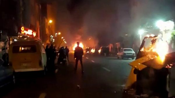 "At least 9 more people were killed and some 100 were arrested overnight as unrest across Iran entered a sixth day, Iranian media said. The country's supreme leader accused ""enemies of Iran"" of orchestrating the demonstrations, but analysts believe the root cause lies within Iran itself. ""What we are seeing now is the result of a sort of distrust between the state and the people,"""